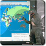 IMAGE: Station computer and Godzilla
