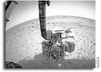 Spirit Flexes Its Arm To Use Microscope On Mars' Soil