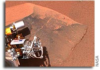 Healthy Spirit Cleans a Mars Rock; Opportunity Rolls