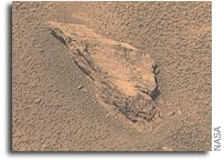 Opportunity Inspects Stone Ejected From Crater