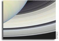 NASA's Hubble and Cassini View Saturn From Far And Near