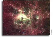 Stormy Cloud of Star Birth Glows in New Spitzer Image