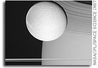 Dione, Saturn, and the Rings (1)