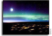 ISS Crew Photographs Aurora Borealis and city lights in Scandanavia
