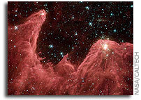 Spitzer Space Telescope Captures Cosmic Mountains of Creation