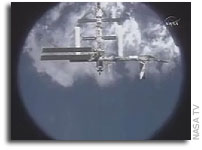 STS-116 Leaves New Truss Segment, Crew Member With Station