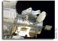 Spacewalkers Press Ahead; Controllers Deploy Radiator