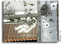 Crew Completes Truss Installation, First Spacewalk