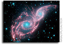 Galaxies Don Mask of Stars in New NASA Spitzer Image