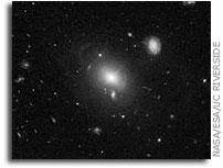 NASA Hubble Space Telescope Spies Shells of Sparkling Stars Around Quasar