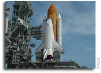 Space Shuttle Atlantis Payload Readied for Trip to the Pad as Tanking Test Wraps Up