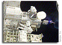 STS-117 Spacewalkers Work to Activate Truss