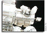 Astronauts Conducting STS-118's Fourth Spacewalk