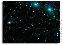 Spitzer nets thousands of galaxies in a giant cluster