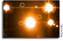 Astronomers find the most distant star clusters hidden behind a nearby cluster