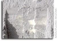 Bright Chunks at NASA Phoenix Lander�s Mars Site Must Have Been Ice