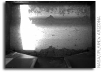 Phoenix Mars Lander Rasps Frozen Layer, Collects Sample