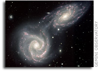Siamese Twin Galaxies in a Gravitational Embrace