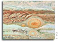 Three Red Spots Mix it Up on Jupiter