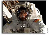 Schlegel completes first spacewalk