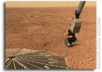 NASA's Phoenix Mars Lander Inspects Delivered Soil Samples