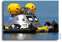 Pararescuemen conduct water test of new NASA capsule