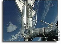 Hatches Opened Between Space Station and Shuttle Discovery at 7:09 p.m. EDT