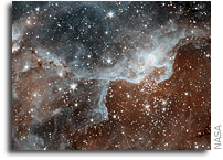 NASA'S Spitzer Sees The Cosmos Through 'Warm' Infrared Eyes