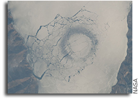 Space Station Image: A circle in thin ice in Lake Baikal, Russia