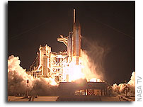 NASA'S Shuttle Discovery Heads to Station After Predawn Launch