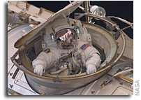 Photo: Entering the Space Station After a Long EVA