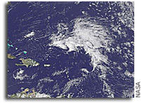 GOES-13 sees an extraordinarily early Atlantic low in the tropics