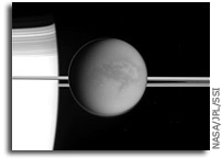 Photo: Closeup of Titan and Saturn's Rings