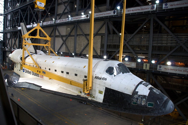 Lifting Atlantis from horizontal to vertical in the Vehicle Assembly Building prior to mating with external tank and solid rocket boosters for her last mission.