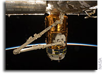 Photo: Kounotori2 H-II Transfer Vehicle Docked at ISS and Grappled by Candarm2