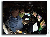 Photos: Inside the Space Station Cupola Controlling Candarm2 as it Moves HTV2