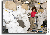 Image: Cady Coleman Hangs Out With Three Empty EVA Suits