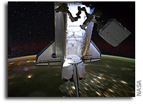 Stunning Images: ISS and Shuttle Fly Over Earth At Night - Stars Above, Lights Below