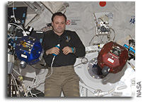Photo: Astronaut Ron Garan Works With SPHERES on The International Space Station