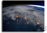 Photo: Clouds, Lightning, Airglow, and Lights of Civilization in Africa As Seen From Space