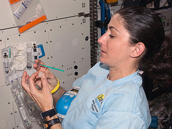 female astronaut drinking water in space - photo #9