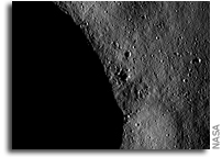 NASA Dawn Image of Asteroid Vesta: Blocks of ejected material and small craters near a crater rim