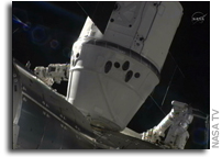 SpaceX Dragon Attached to Space Station in Spaceflight First