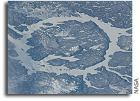 Photo: Impact Crater: Manicouagan Reservoir in Quebec, Canada As Seen From Orbit