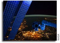 Photo: Space Station Hardware Glows During a Night Pass Over Earth