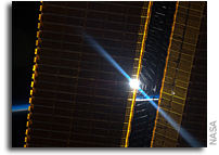 Photo: Space Station Solar Arrays Catch a Sunrise