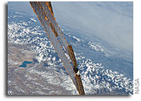Space Station Solar Panels With The Himalayas As a Backdrop