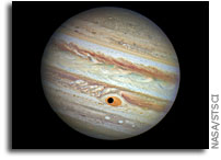 Ganymede Passes In Front of Jupiter's Great Red Spot