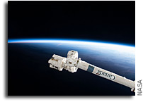Canadarm2 Reaches Across The Night Skies of Earth