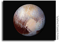 'Pluto Dazzles in False Color' from the web at 'http://images.spaceref.com/news/2015/nh-pluto-in-false-color.jpg'